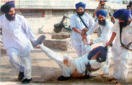 SGPC Task Force members dragging Bhai Mukhtiar Singh of Patiala by his sacred hair.  Bhai Mukhtiar Singh came to talk to  Avtar Makkar regarding the disrespect of Guru Ganth Sahib Ji attacked by  SGPC 'task force'. <br />