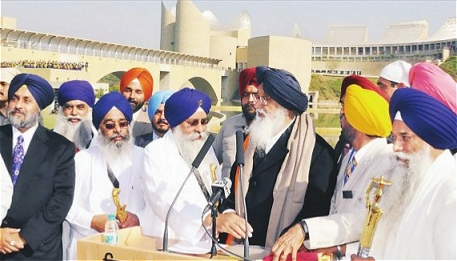 Badal given Siropa by Takht Jathedars for his